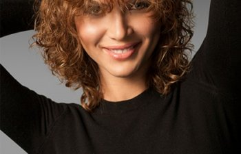 Young woman in wig with curly hair