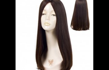 Dummy head in a long dark wig